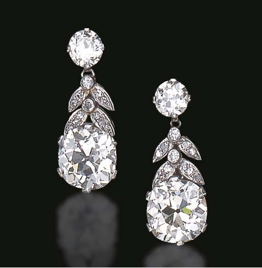 AN ELEGANT PAIR OF DIAMOND EAR PENDANTS Each suspending an old mine-cut diamond, by single-cut diamond and diamond collet foliate links, from an old European-cut diamond, mounted in platinum, circa 1930 The total weight of the old mine-cut diamonds is approximately 9.07 carats