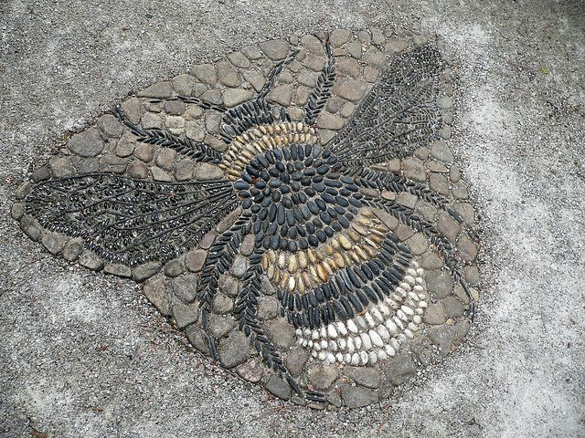 Beautiful stone mosaic bee in a pathway.