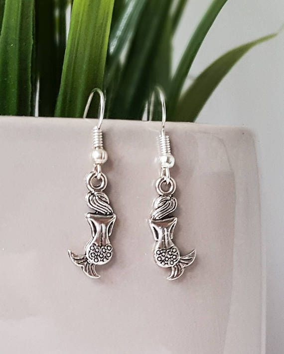 Check out this item in my Etsy shop https://www.etsy.com/uk/listing/510310062/mermaid-earrings-mermaid-charm-silver