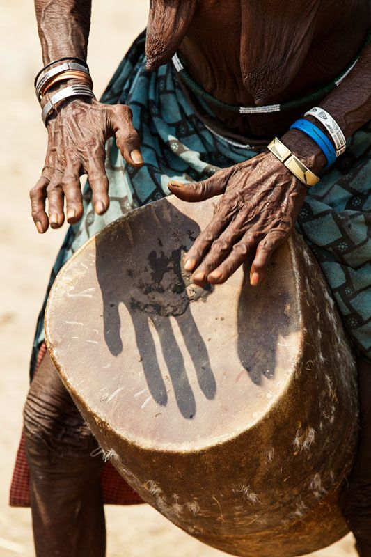 Old woman from the Muchimba or Himba tribe, playing the drum during the 2 day celebration of Mufinco (where they celebrate the change from girl to woman) - Angola ‹ Imagevue Gallery - Johan Gerrits