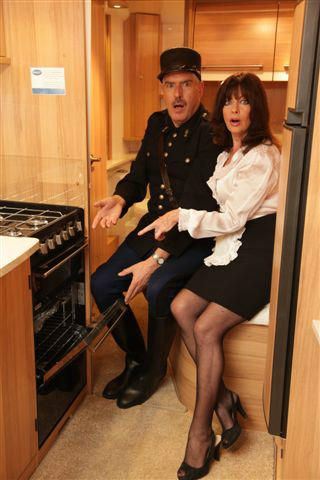 Officer Crabtee and Yvette Carte-Blanche from 'Allo 'Allo are amazed what you can find in a Bailey caravan