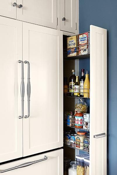 Handige kast.......A paneled, counter-depth fridge gets its seamless built-in look from a flush pantry pullout on one side and deep cabinets on top. | Photo: Joe Schmelzer | thisoldhouse.com