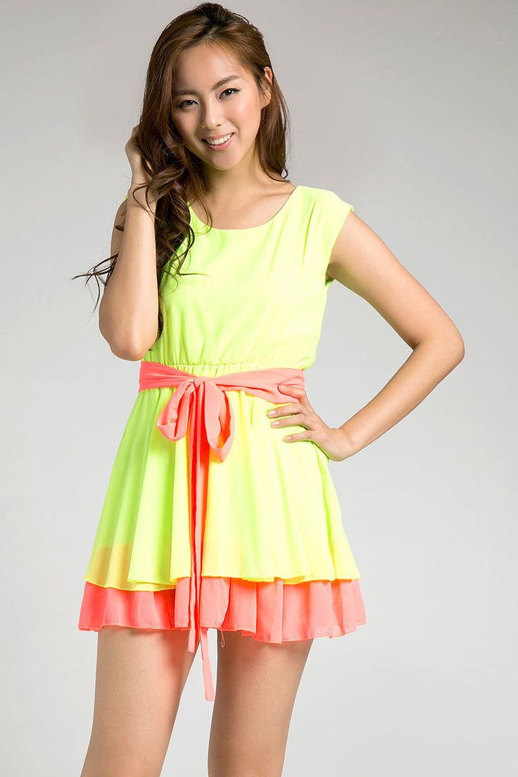 Double Neon Dress by Belle Ivy in yellow and orange. This dress will surely catch people's attention with its neon color. With green and orange color it can go with sneakers or just a sandals. The perfect dress for your casual wear.  http://www.zocko.com/z/JDWj4