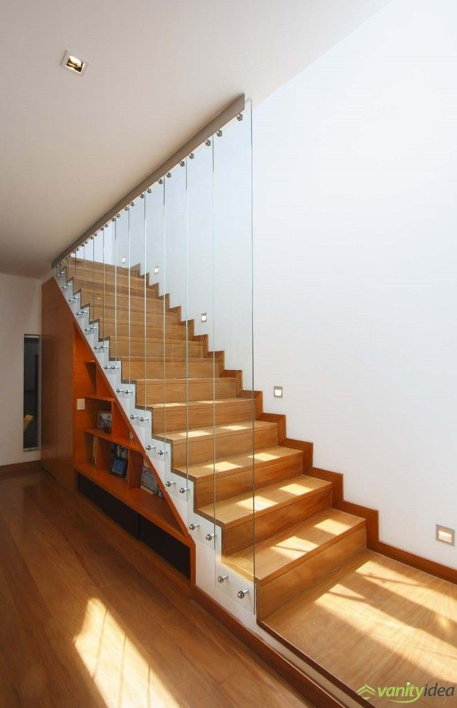 wooden staircase with glass paravane