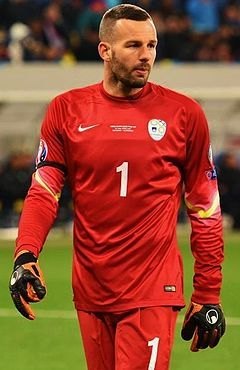 Samir Handanović ( Slovene pronunciation:  ; born 14 July 1984) is a Slovenian professional footballer who plays as a goalkeeper for Italian club Inter Milan . During the 2010–11 Serie A season he saved a total of six penalty kicks, equalling an all-time league record set in the 1948–49 season. Having previously represented Slovenia's under-21 team, Handanović made his senior international debut in 2004. He has gone on to earn 81 caps for his country, the second-most appearances for Slove...