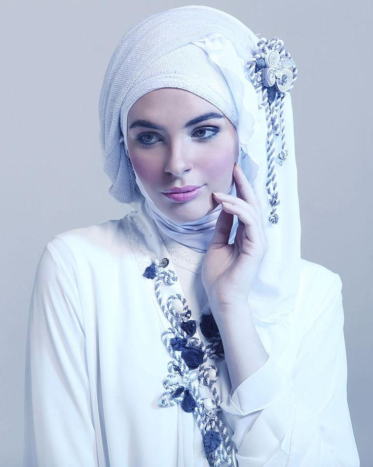 Abaya with rope collar detail and rope flower corsage by Bilqis. Silver glitter scarf by Tiara Kerudung. White 'wavy' scarf by Raudhah Firdaus.