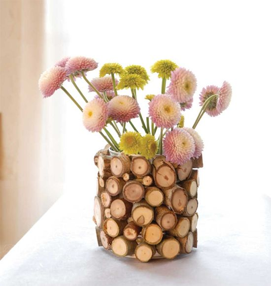 DIY: Wood Slice Vase - gather slightly larger branches cut into short pieces and adhere to old aluminum can or glass vase.