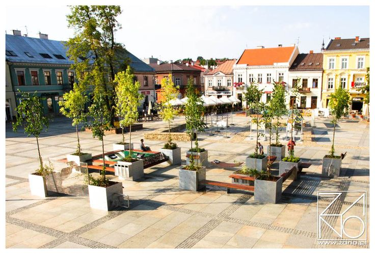 Great idea how to create a modern composition of street furniture at the Main City Square. Beautiful, minimalistic planters made of stainless steel...