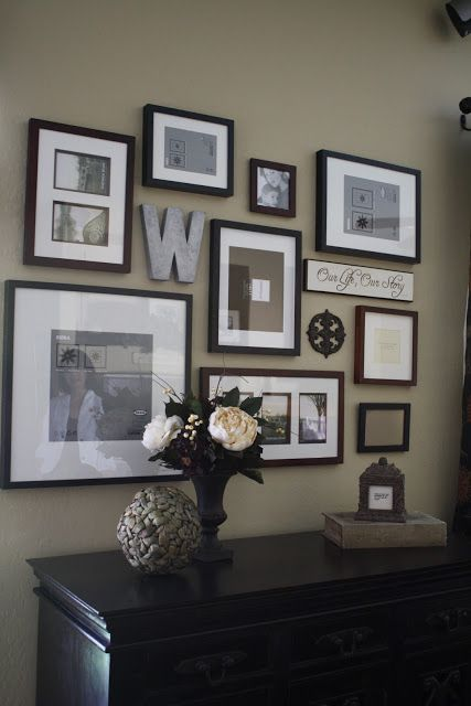 special features (large W, metal ornament, board with saying) add another dimension of interest to this photo wall