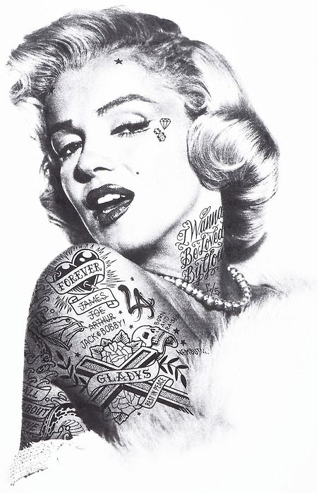 i hope people don't get mad at this... i think she would have been sexier with a tat or two, but not covered