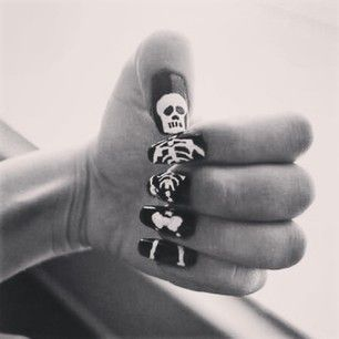 A nail-by-nail skeleton. | 27 Delightfully Spooky Ideas For Halloween Nail Art