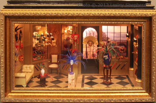 Roombox display of Venetian Carnival masks in 1:12 scale.