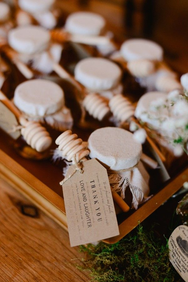 Honey pot favours for guests to take home.