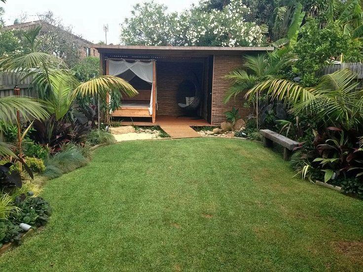 Balinese Garden Northern Beaches Sydney – Tropical Garden Design. Lush Tropical Garden Design. Palms, Glossy Foliage, Water Feature, Outdoor Hut/Pavilion. Balinese Style Garden Design and Construction. Tropical Garden Landscaping.