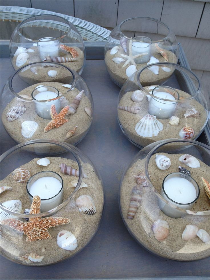 DIY beach themed Wedding Table Center Pieces - seashells, sand, tea light candles, glass bowls More