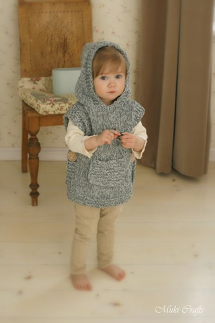 This is knitting pattern for poncho Phoebe with a hood and pocket. The pattern includes instructions for making a cute lop-eared bunny poncho with a fur tail. Knit this poncho in cotton+silk for sun protection in summer or in alpaca for layering on colder days.