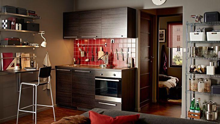 Modern dark kitchen with TINGSRYD fronts and a dark worktop