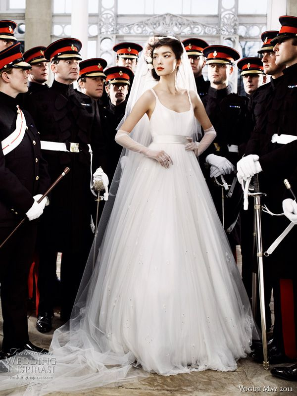 Jenny Packham Wedding Dress Vogue - model Sun Fei Fei with Officers of the Household Cavalry Mounted Regiment. Photographer - Mario Testino.  British Vogue May 2011