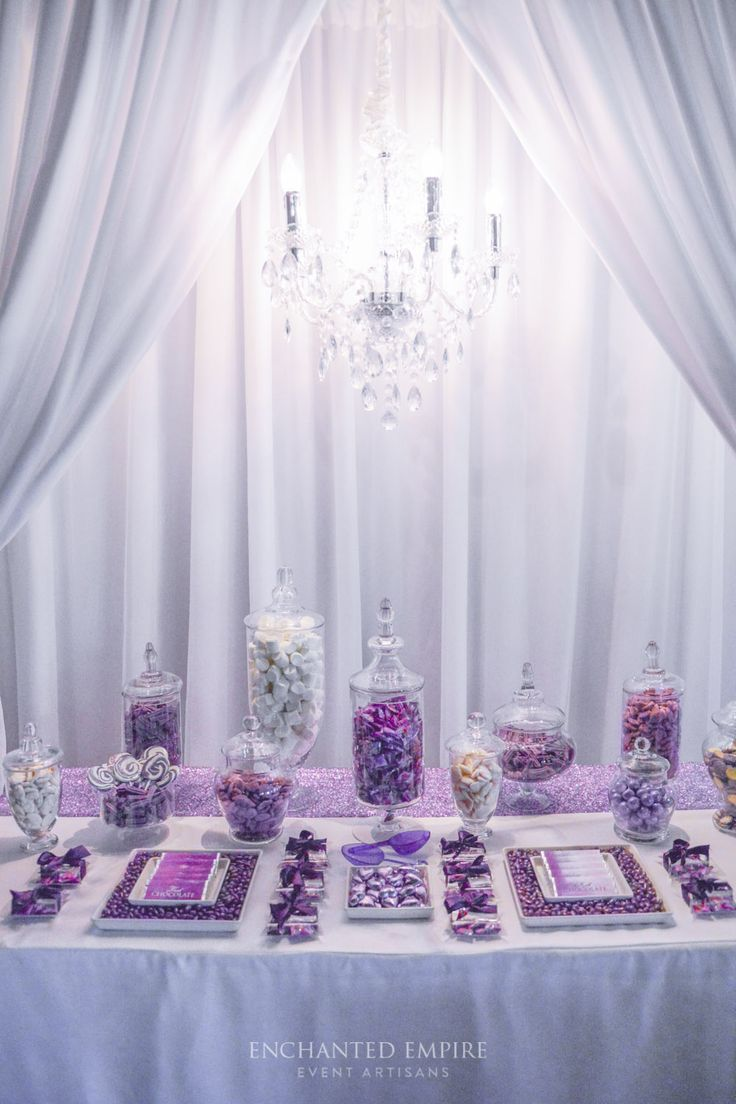 Draped in cascades of white curtaining, illuminated by a gorgeous, glistening chandelier, this candy bar was one that definitely impressed the crowds. Perfectly packaged sweets, with custom designed chocolate bars, and colour matching candy, it's no surprise this beautiful couple's day had all the exquisite elements to create a very special treat. Dessert Table. See the full film on our YouTube channel: https://youtu.be/91p-puqmn-k