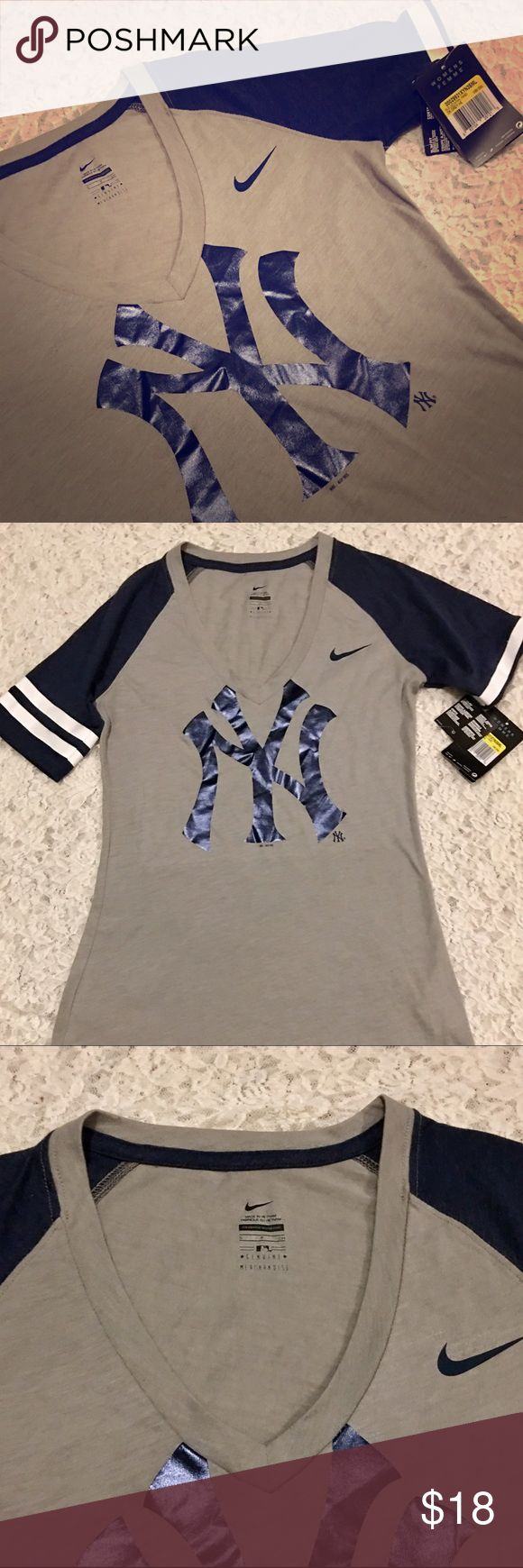 NEW YORK YANKEES 'NIKE FEMME' V NECK SHIRT SZ S Brand new with tags, New York Yankees 'Femme Nike' V Neck T Shirt, Size Small. MATERIAL Composition is 60% Cotton & 40% Polyester & it is a Slim Fit Shirt with No Flaws or Defects. I'm Just Not a NY Fan. Retail was 40.00$ Offers Welcome, So Make One! Nike Tops Tees - Short Sleeve