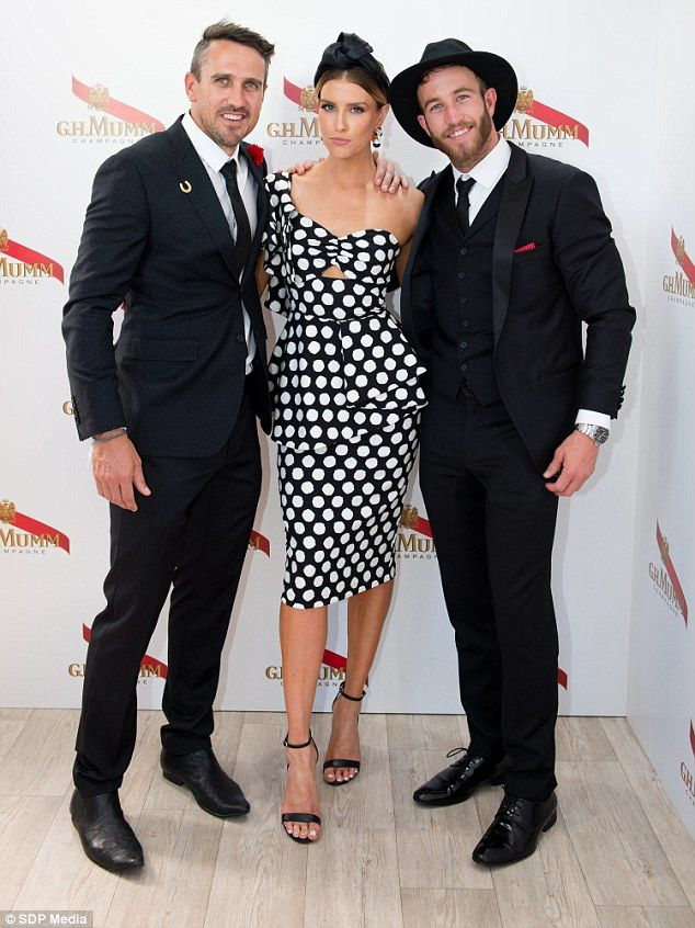 Familiar faces: While at the star-studded event, Erin happily posed for photos alongside Australian Survivor contestants Lee Carseldine (left) and Sam Webb (right)