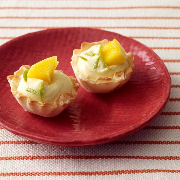 Tropical Cheesecake Tarts - Fresh mango is blended with cream cheese and lime zest in these super-easy tarts. Try other tropical fruits such as pineapple or papaya as well.