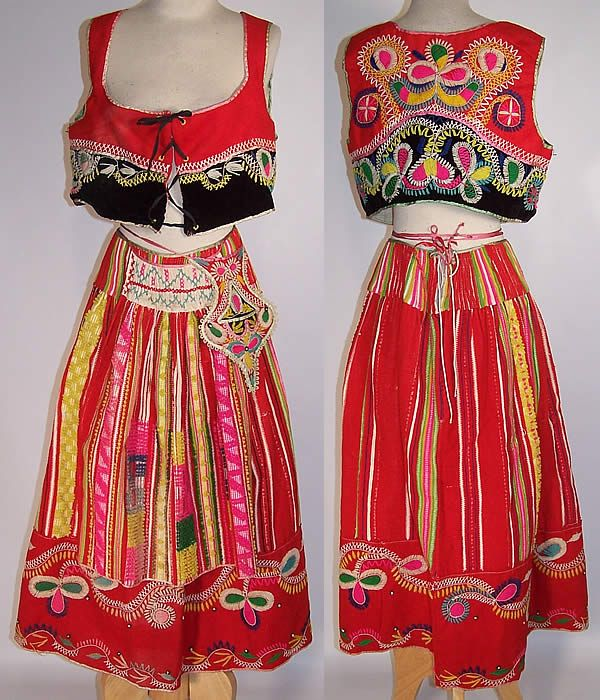 Vintage Portuguese folk costume with embroidered wool vest, skirt, apron, and purse