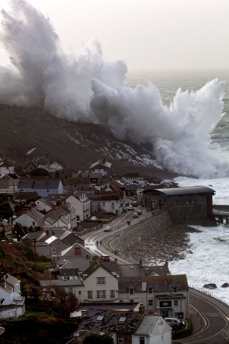 Huge waves pound Sennen in Cornwall Feb 8, 2014.. I don't know who posted this as Porthleven harbour but I was there! This is definitely Sennen Cove!