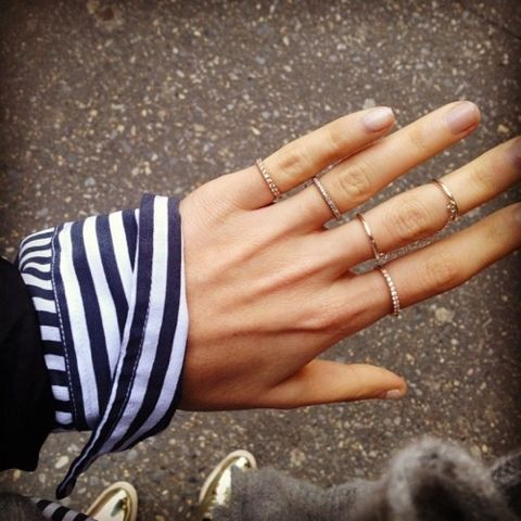 love these dainty rings on all fingers.