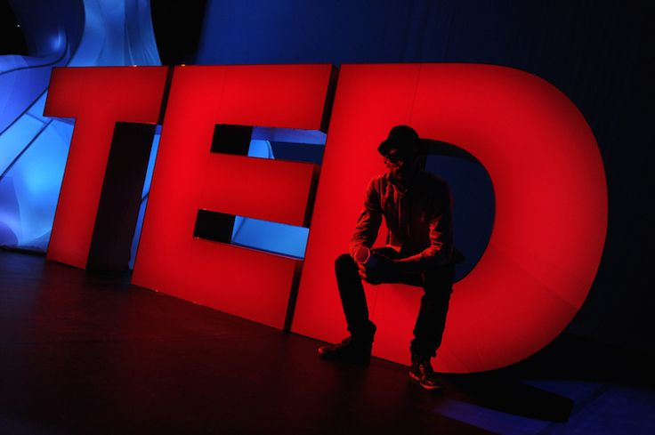TED Prize winner JR meets the oversized onstage TED logo. Behind the scenes at TED2011, February 28 - March 4, Long Beach, CA. Credit: James Duncan Davidson / TED
