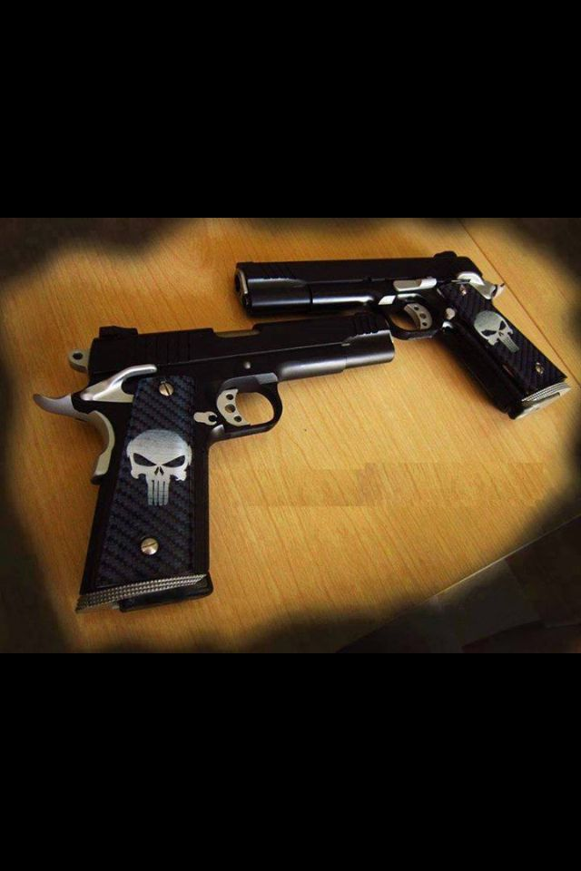 I NEED these!!!!!!!!!!! #The Punisher emblem on the handles just makes these gorgeous guns that much more aweome