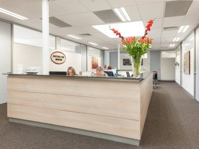 Open reception office space with slight wood grain.