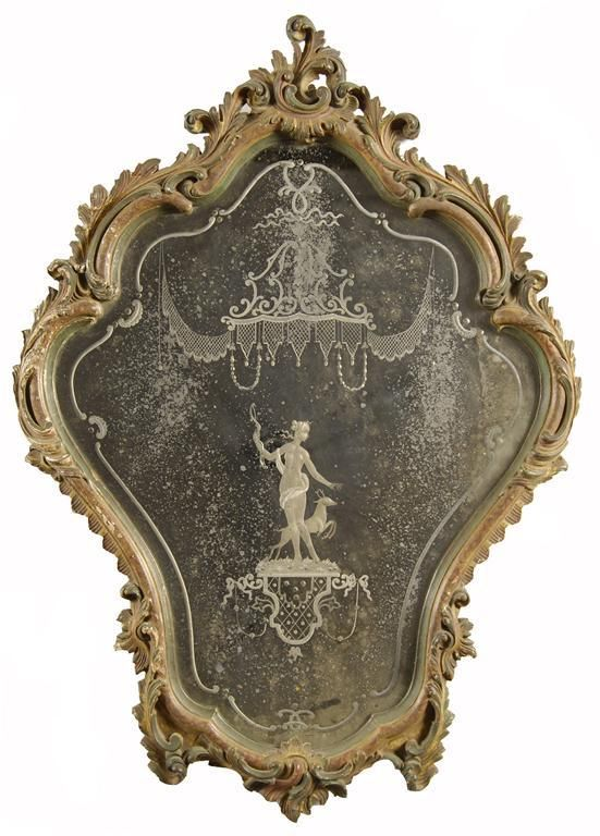 A pair of Venetian carved and polychrome decorated mirrors, each with a cartouche shape plate etched with classical figures, the frames with scrolling foliage, mid 20th century, 33.5 x 24in (85 x 61cm).