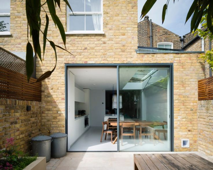 Architecture for London uses slate and brick for tandem house extensions