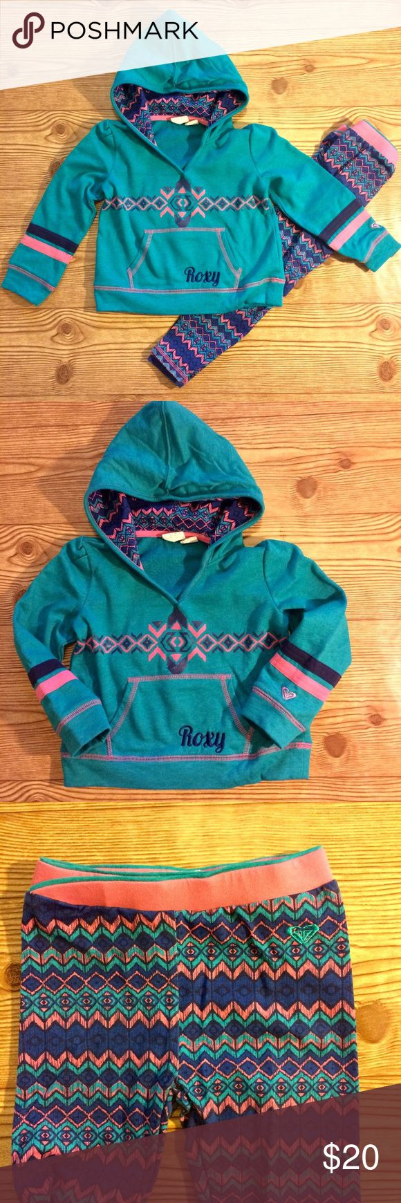 Roxy 2-piece Matching Hoodie and Legging Set Sweater with hood and legging set. Cotton blend. Embroidered ROXY on the front pocket. Elastic waist band on leggings with Roxy logo embroidered. Lining on Hoodie matches the leggings. EUC. Roxy Matching Sets