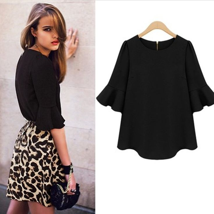 A stunning blouse featuring a back zipper and flared bell 3/4 sleeves.  Avaliable in Red, Black and Cream