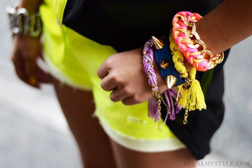 neon bracalets + yellow short