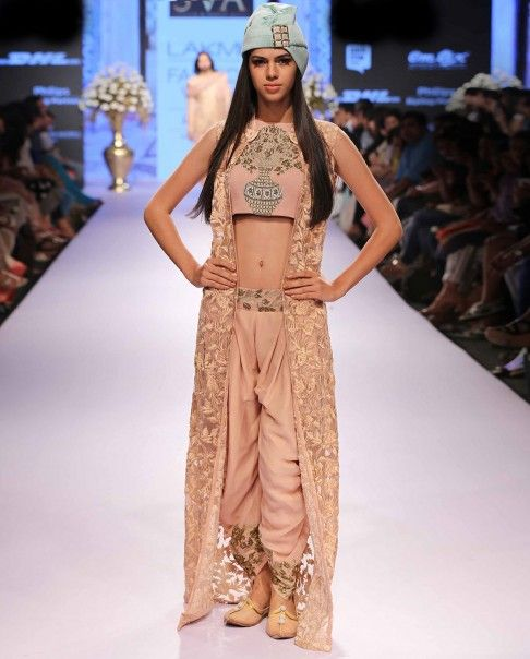 Old rose pink thread embroidered front open jacket. Zardozi jaal embroidered flower pot motif adorn the matching crop top. Matching old rose patiala pants with embroidered belt.Disclaimer: There might be a slight color variation in this item as this image is from the actual runway show.Wash care: Dry clean onlyCap worn by the model is only for styling purpose