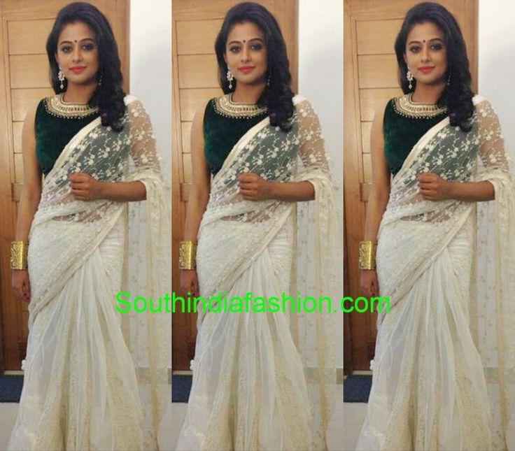 Actress Priyamani in white lace saree paired by with sleeveless high neck green velvet blouse with embroidery around neck. This outfit is from Pranaah by Poornima Indrajith.