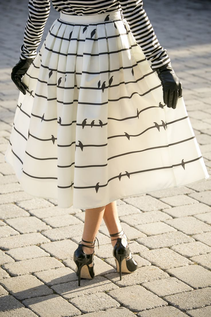 Compose yourself a love song with this delightful midi skirt! Printed with stripes and birds, this simple design exudes a unique charm that makes you look glamorously chic and graceful. Put on your heels and enjoy a fabulous night.  Dino Petrocelli Photography @northofmanhattan