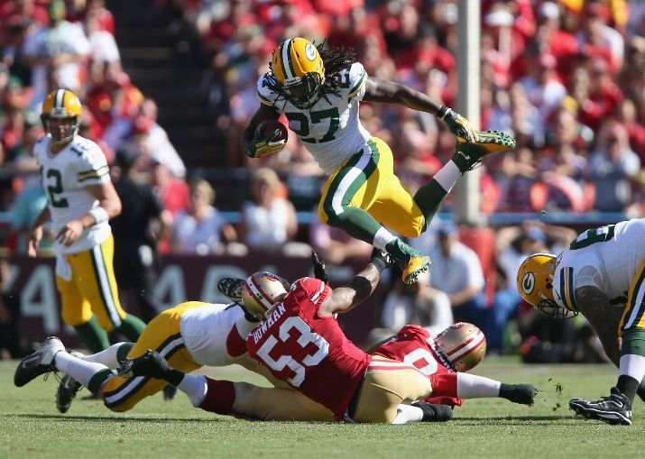 Running back Eddie Lacy #27 of the Green Bay Packers leaps over NaVorro Bowman #53 of the San Francisco 49ers in the fourth quarter at Candl...