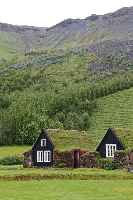 Purple hill over traditional Icelandic farmhouses by daniel.virella, via Flickr