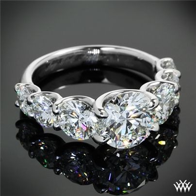 A stunning masterpiece, this beautiful Custom Diamond Engagement Ring features a graduating row of A CUT ABOVE® Hearts and Arrows Diamonds leading to a brilliant 1.60ct A CUT ABOVE® Hearts and Arrows Diamond. The U-Prong design allows for maximum visibility of the diamonds.
