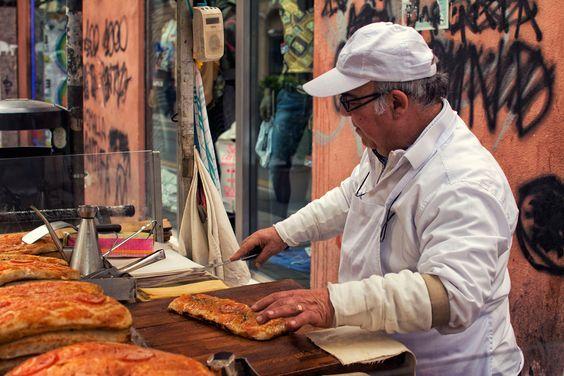 Sfincione: a big sheet of  dough topped with tomato, onion, anchovies and caciocavallo.