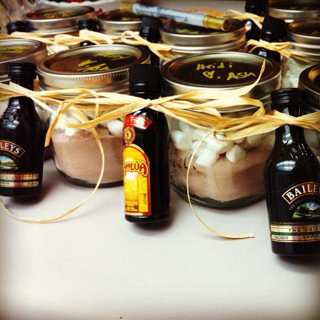 Grown-up hot chocolate gift in a mason jar  - hot chocolate powder  - marshmallows   - mini baileys or kahlua bottles   - raffia or ribbon
