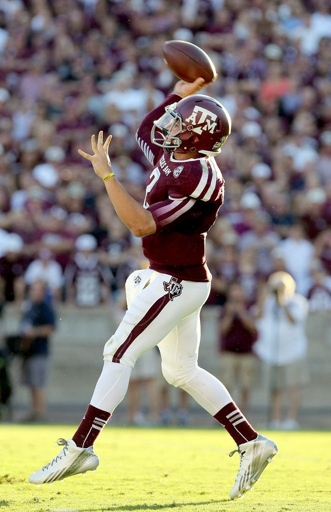 Johnny Manziel #2 of the Texas A&M Aggies completes a pass agains the Southern Methodist Mustangs in the first half on September 21, 2013 at Kyle Field in College Station, Texas.