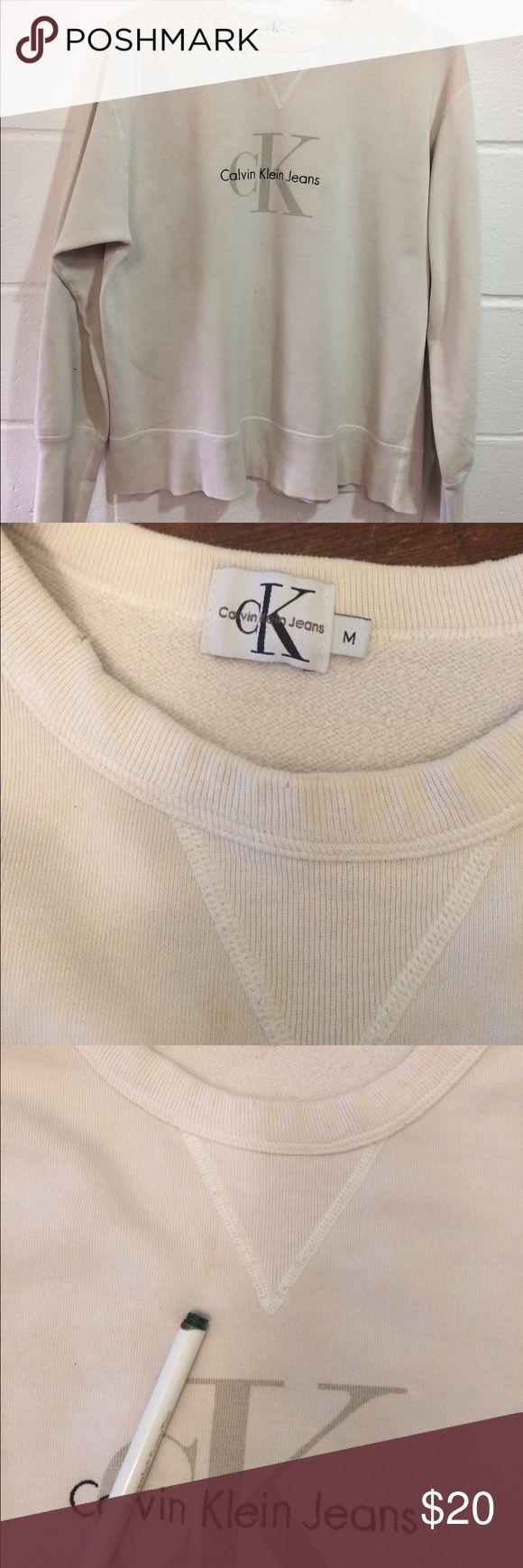 "Vintage Calvin Klein big logo crewneck sweatshirt Men's medium vintage  big ""CK"" logo sweatshirt. Flaws include stains shown in pics. Cream colored. Calvin Klein Sweaters Crewneck"