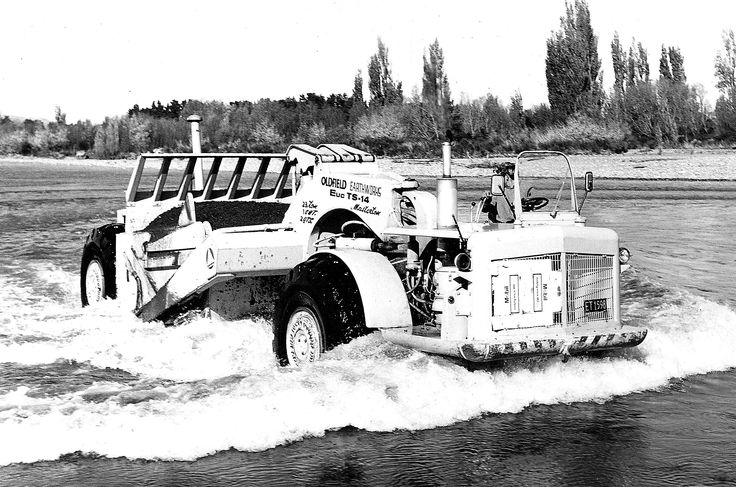 TS-14's could go anywhere!. This particular example belonging to Oldfield Earthworks of Masterton, fords a river in the Wairarapa, 1967. Note the cardboard placed to keep the bow wave out of the radiator.