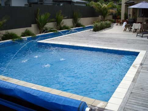 Swimming pool with lane for laps