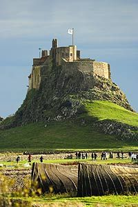 Lindisfarne Castle, Holy Island, Northumberland - the island is accessible via a causeway only during low tide and is extremely popular with locals and tourists alike.